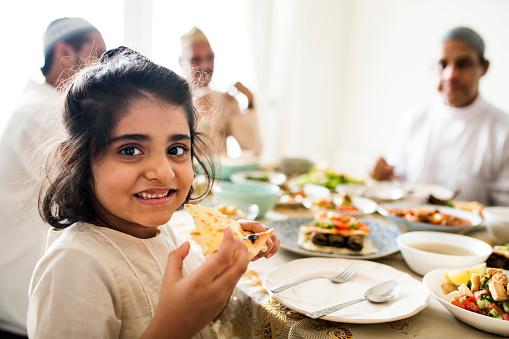Muslim family having a Ramadan feast 1022920122