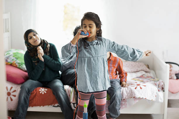 muslim family listening to girl singing in bedroom - parents praise stock pictures, royalty-free photos & images