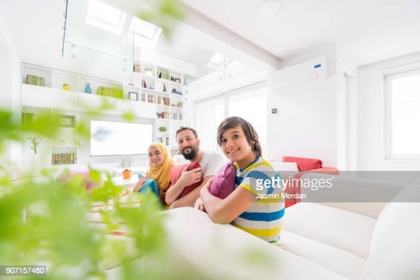 Muslim family living in modern beautiful house