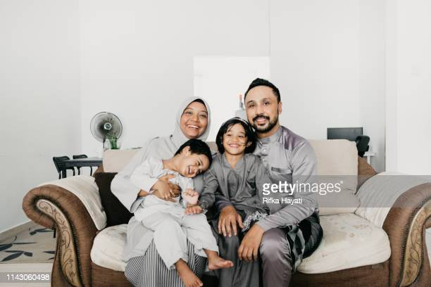 muslim family portrait for eid mubarak - eid ul fitr stock pictures, royalty-free photos & images
