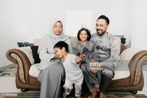 muslim family portrait for eid mubarak - hari raya celebration stock pictures, royalty-free photos & images