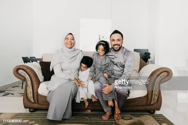 muslim family portrait for eid mubarak - eid ul fitr photos stock pictures, royalty-free photos & images