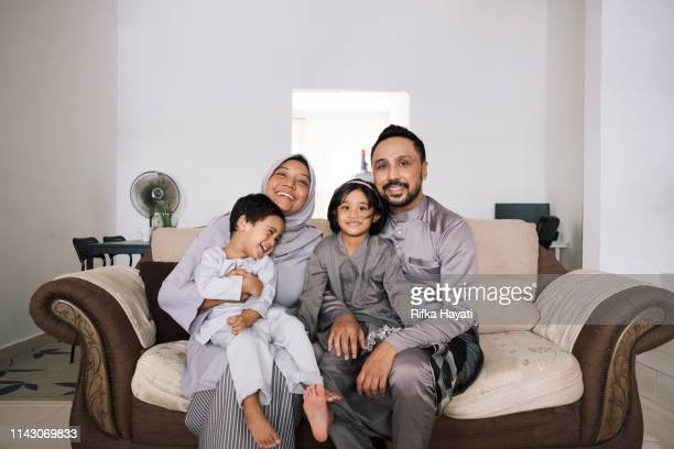 muslim family portrait for eid mubarak - eid mubarak stock pictures, royalty-free photos & images