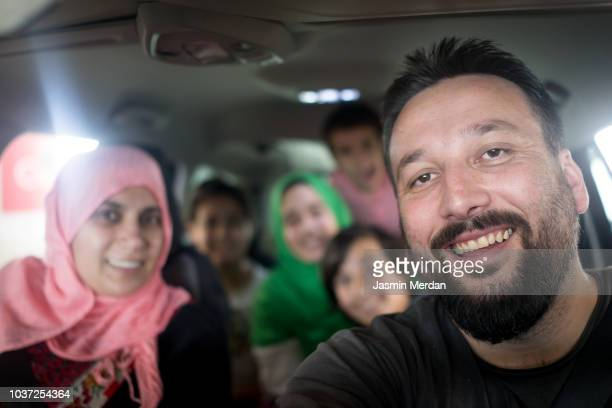 Muslim family portrait in car