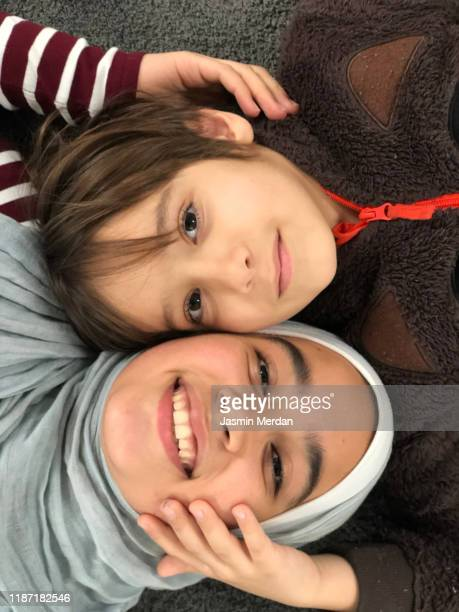 muslim family portrait in love - affectionate stock pictures, royalty-free photos & images