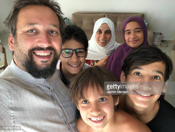 muslim family selfie at home - turkey middle east stock pictures, royalty-free photos & images