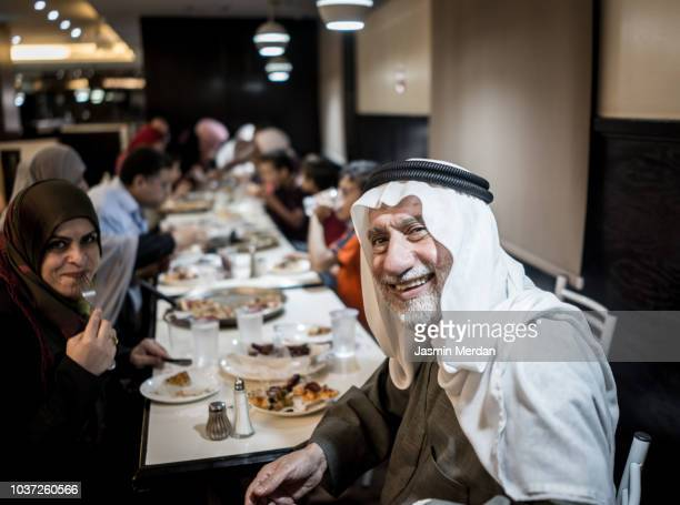 Muslim family together in restaurant