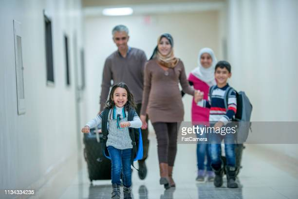 muslim family waiting to leave - refugee stock pictures, royalty-free photos & images