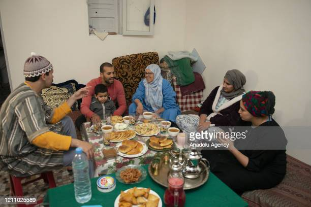 Muslim family waits to break their fast during the first day of Ramadan in Rabat Morocco on April 25 2020