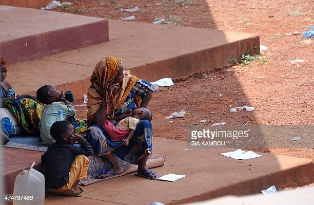 A Muslim family who seeked refuge at the Central African Customs chartering centre in Bangui look on February 25 2014 at a humanitarian convoy...