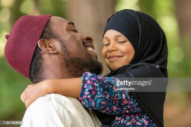 muslim father and daughter at her first day of school - islam stock pictures, royalty-free photos & images