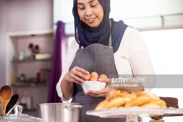 Muslim female baker preparing to bake a cake