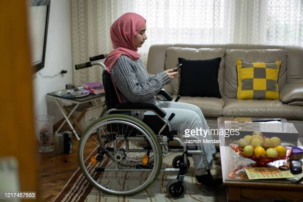 muslim female in wheelchair daily life at home - gulf countries stock pictures, royalty-free photos & images