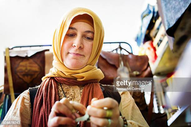 Muslim female leather worker in her workshop close-up