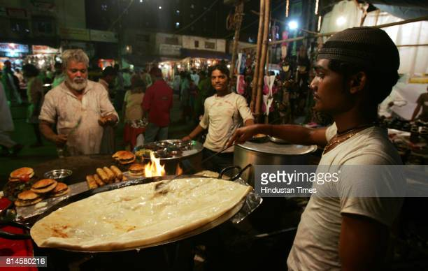 Muslim Festivals Food EID Fayaz Khan and Vakhil Khan prepares the Shahi Paratha at Garib Nawaz Fast Food Corner in Dharavi for Iftaar in holy month...
