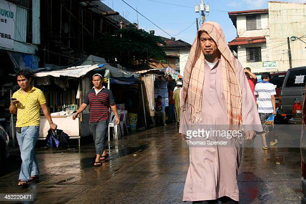 Muslim Filipino walks away after prayers at the Golden Mosque in the Quiapo area of Manila