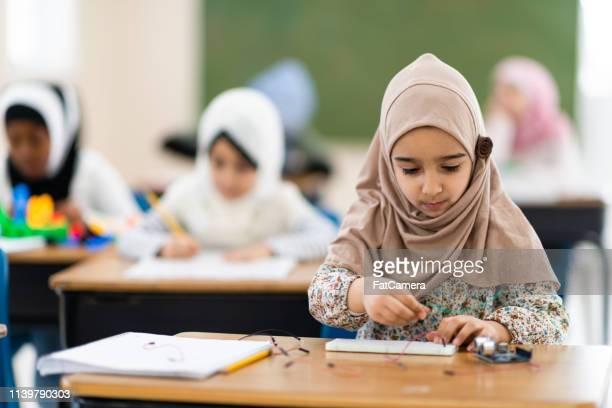 Muslim girl building