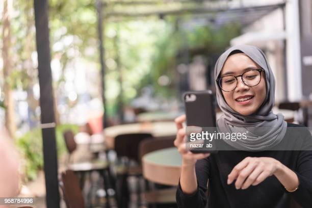 Muslim girl checking social media.