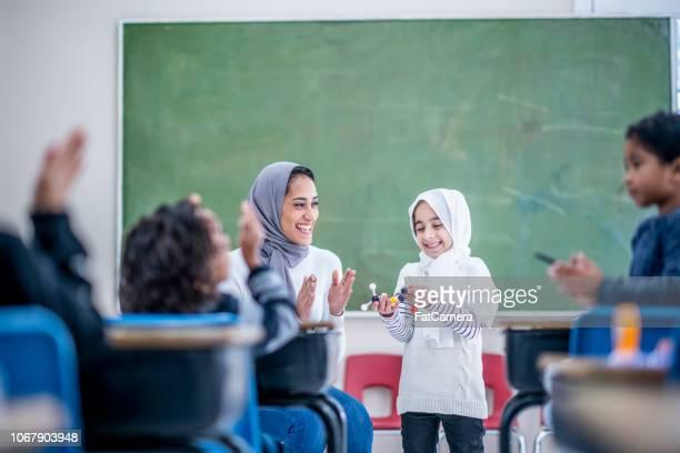 Muslim girl giving presentation