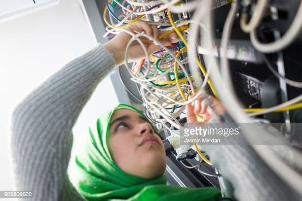 muslim girl in server room - stem stock photos and pictures