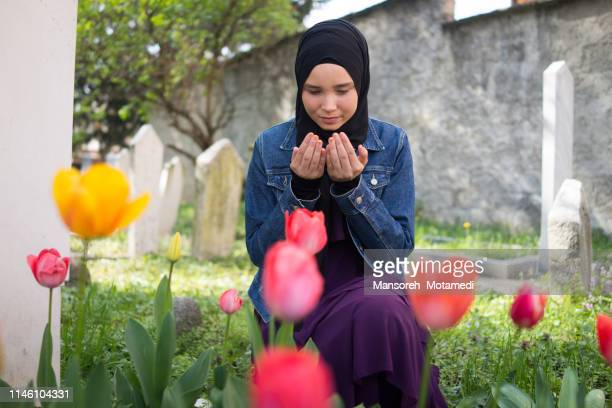 muslim girl is praying - argentina traditional clothing stock photos and pictures