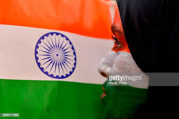 Muslim girl kisses the Indian flag during independence day celebrations in Ajmer