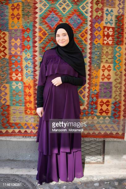 muslim girl out door - persian rug stock photos and pictures
