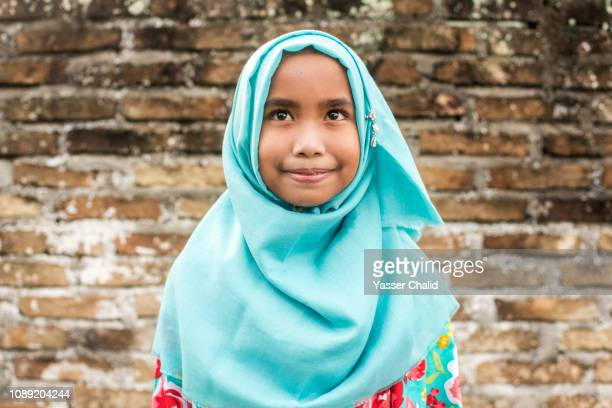 muslim girl - traditional clothing stock pictures, royalty-free photos & images