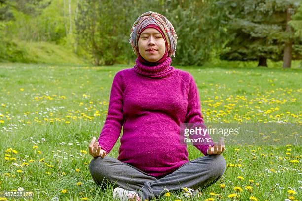 Muslim Girl Practicing Prenatal Yoga