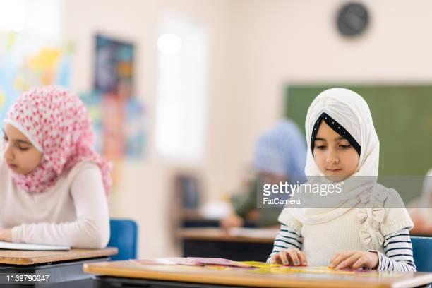Muslim girl sitting in class