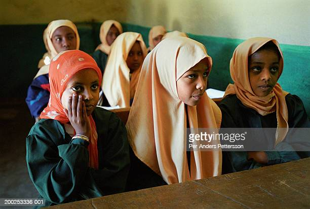 muslim girls attend class in a school in harar, ethiopia - per-anders pettersson stock pictures, royalty-free photos & images