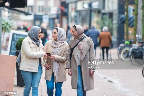 muslim girls in holland - moroccan culture stock pictures, royalty-free photos & images