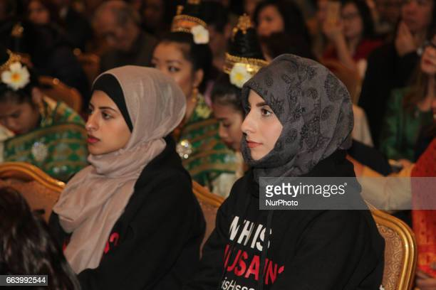 Muslim girls listen to speeches about diversity and acceptance during the International Day for the Elimination of Racial Discrimination in Markham...