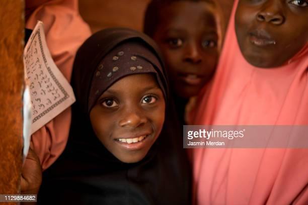 Muslim girls reading Koran