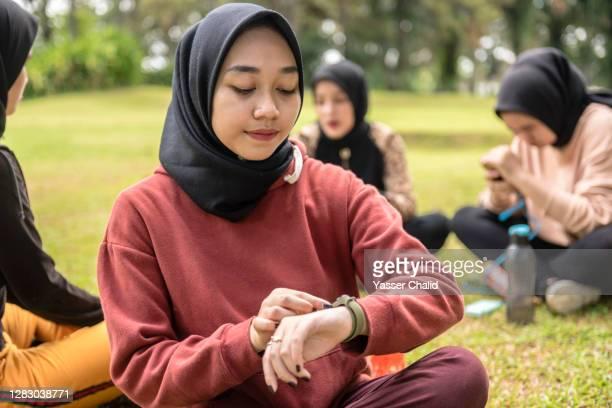 Muslim Girls using Smart Watch