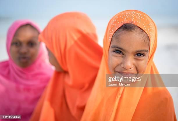 Muslim girls with class on beach