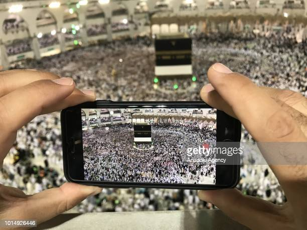 Muslim Hajj pilgrim records a video of circumambulating around the Kaaba Islam's holiest site located in the center of the Masjid alHaram in Mecca...