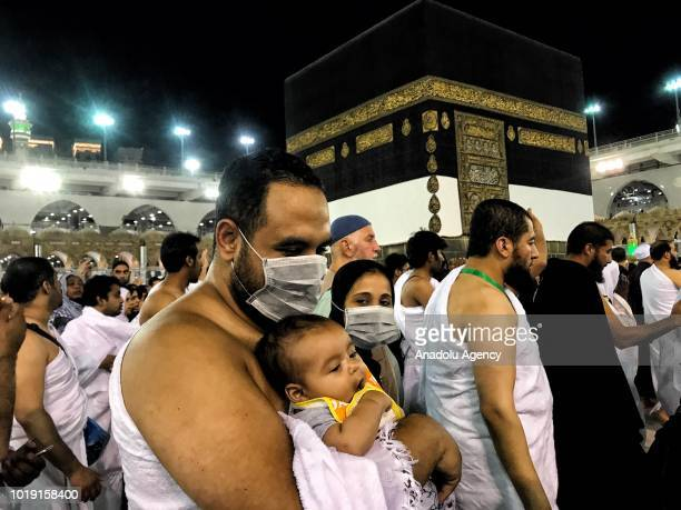 Muslim Hajj pilgrims circumambulate around the Kaaba Islam's holiest site located in the center of the Masjid alHaram in the holy city of Mecca Saudi...