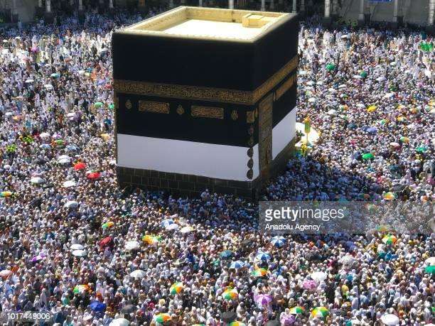 Muslim Hajj pilgrims circumambulate the Kaaba Islam's holiest site located in the center of the Masjid alHaram in Mecca Saudi Arabia on August 14 2018