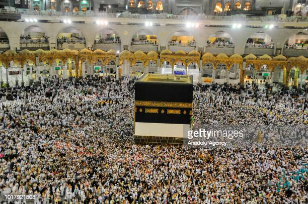 Muslim Hajj pilgrims circumambulate the Kaaba Islam's holiest site located in the center of the Masjid alHaram in Mecca Saudi Arabia on August 17 2018