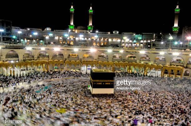 Muslim Hajj pilgrims circumambulate the Kaaba Islam's holiest site located in the center of the Masjid alHaram in Mecca Saudi Arabia on August 17 2018