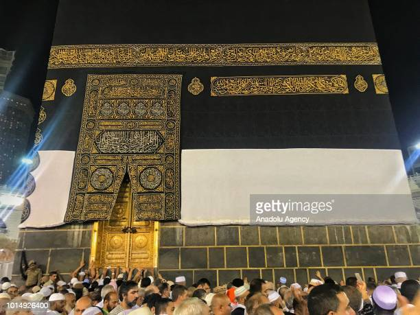 Muslim Hajj pilgrims try to touch Kaaba stone as they circumambulate around the Kaaba Islam's holiest site located in the center of the Masjid...