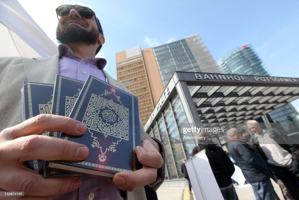 A Muslim holds copies of a Koran he is distributing for free at Potsdamer Platz on April 14, 2012 in Berlin, Germany. Islamic radicals in Germany have launched an unprecedented nationwide campaign to distribute 25 million copies of the Koran, translated into the German language, with the goal of placing one Koran into every household in Germany, free of charge. The group, which calls itself 'The True Religion,' claims that 300,000 copies have already been distributed. German officials have raised serious concerns about the initiative, calling it an abuse of the holy text.