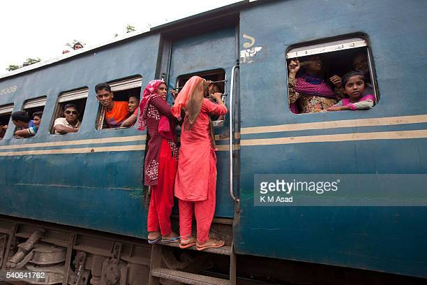 Muslim Homebound people and two women take a risk to travel to their villages ahead of the Eid ulFitr celebrations at the Airport Railway Station in...