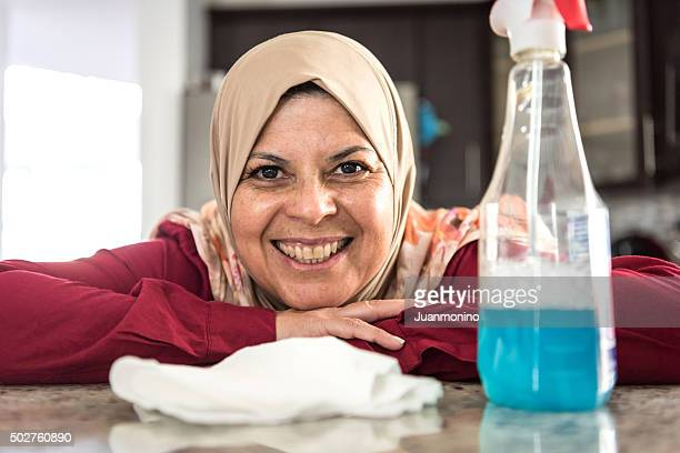 muslim housewife posing at her kitchen - arab women fat stock pictures, royalty-free photos & images