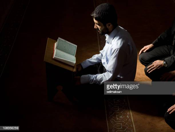 Muslim imam reading qoran in mosque
