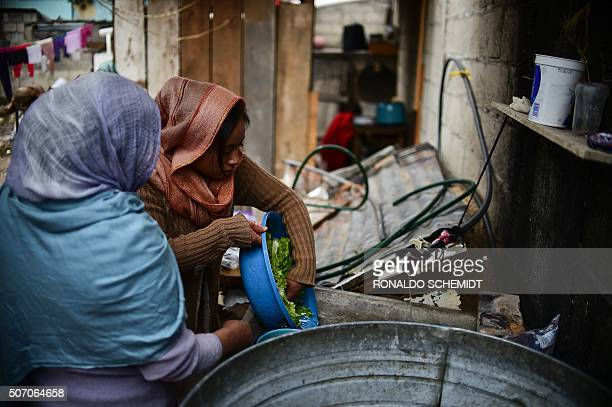 Muslim indigenous women cook at a mosque in the outskirts of San Cristobal de Las Casas, Chiapas state, Mexico on January 22, 2016. A group of 60...