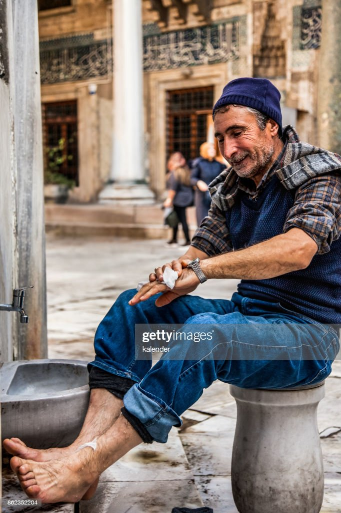 A Muslim Is Preparing For Prayer In The New Mosque Fountain.l : Stock Photo