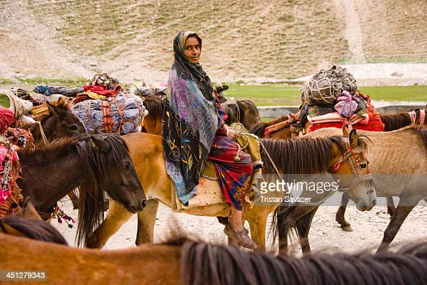 Muslim Kashmiri Gujjars on horses in Drass valley in Indian-administered Kashmir. During the summer months, Kashmiri Gujjars set camps in the meadows...