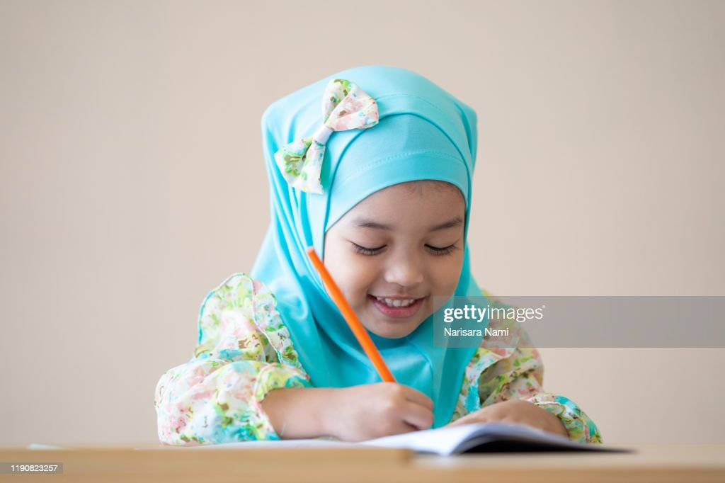 muslim kid doing homework and reading a book kid enjoy learning with happiness at home clevereducation and smart learning concept high res stock photo getty images muslim kid doing homework and reading a book kid enjoy learning with happiness at home clevereducation and smart learning concept high res stock photo getty images